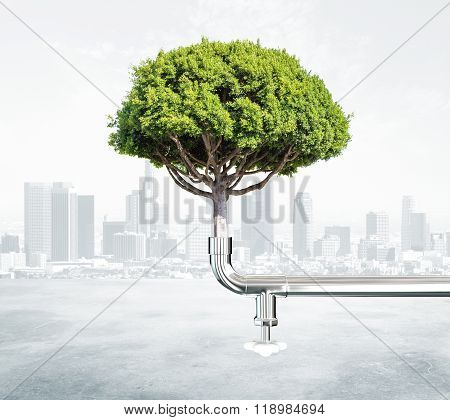 Green Energy Concept With Tree And Water Tap At City Background