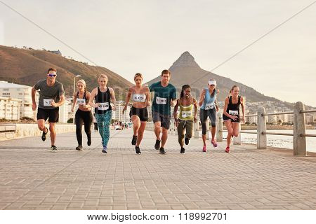 Diverse Group Of Young People Running Race