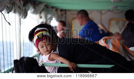 Father and child on a ferry in Philippines