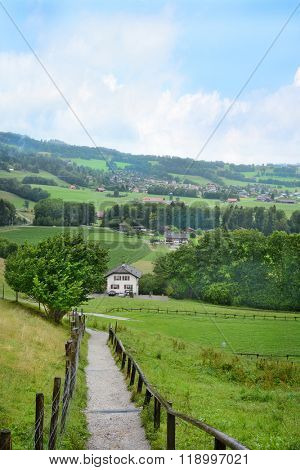 GRUYERES, SWITZERLAND - JULY 8, 2014:  Gruyeres Countryside. The medieval town is an important tourist location in the upper valley of the Saane river.