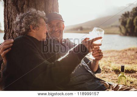 Senior Couple Enjoying Camping Near A Lake