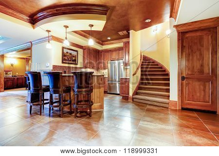 Excellent Kitchen With A Bar And Large Tile Floor.
