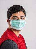 Постер, плакат: indian man wears mask asian man wearing medical mask young indian man wearing protective mask isol