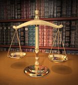 picture of law-books  - brass scales of justice on a desk showing depth - JPG