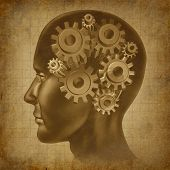 image of frontal lobe  - Human brain represented by gears and cogs on old grunge texture - JPG