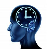 image of frontal lobe  - Human head with time symbol seen inside representing a clock metaphor - JPG
