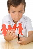 foto of divorce-papers  - Sad boy cutting paper people family  - JPG