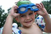stock photo of floaties  - little boy so excited to be swimming - JPG