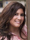 Portrati Plus-Size Hispanic Woman Outdoors Smiling poster