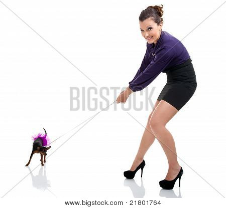 Girl Pulling  Little Dog