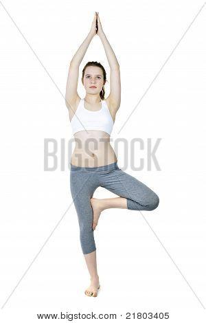 Fit Girl Doing Tree Yoga Pose
