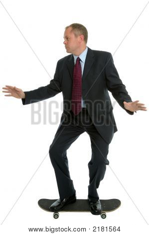 Businessman On A Skateboard