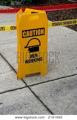 Caution Sign On Sidewalk