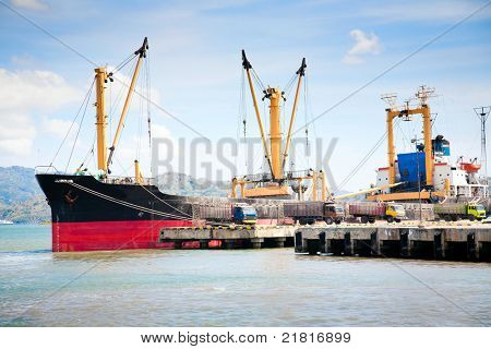 Large cargo ship docked in port