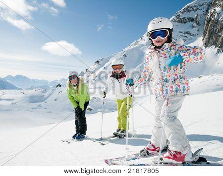 Winter, ski sun and fun - family in ski resort