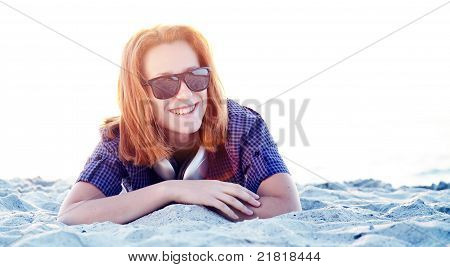 Beautiful Redhead Girl With Headphones At Beach Sand.