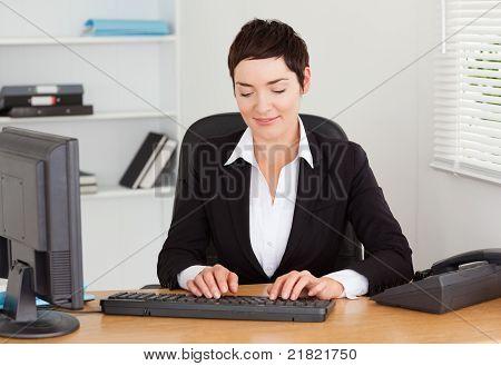 Secretary Typing On Her Keybord