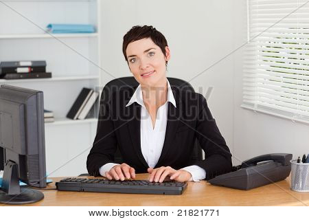 Young Secretary Typing On Her Keybord