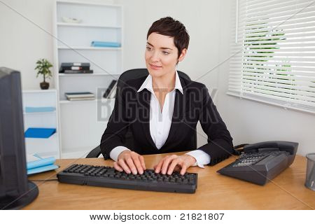 Charming Secretary Typing On Her Keybord