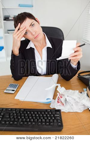Portrait Of A Female Accountant Checking Receipts