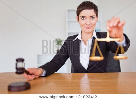Serious Woman With A Gavel And The Justice Scale