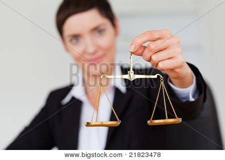 Holding The Justice Scale