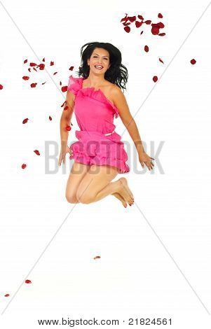 Happy Woman Jumping Through Petals