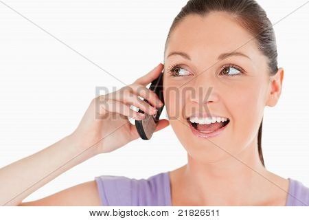 Portrait Of A Good Looking Woman On The Phone While Standing