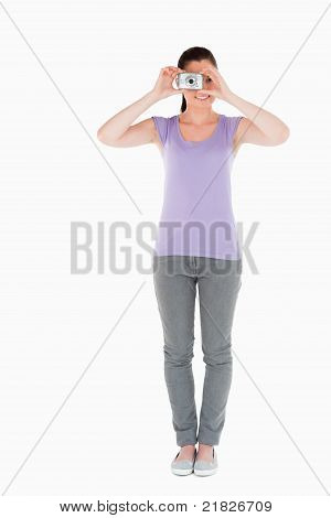 Good Looking Woman Using A Camera While Standing
