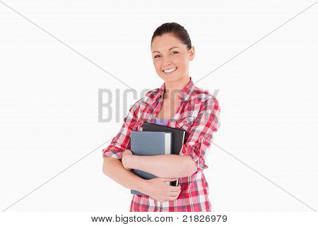 Good Looking Female Posing With Books While Standing