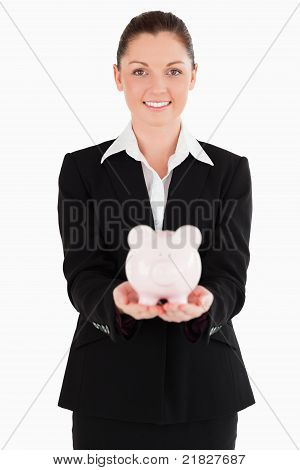 Attractive Woman In Suit Holding A Pink Piggy Bank
