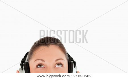 Portrait Of A Pretty Woman Posing With Headphones While Standing