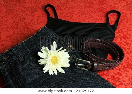 Tank top, skirt, belt and a white flower