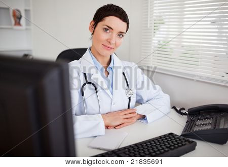 Serious female doctor looking at the camera in her office