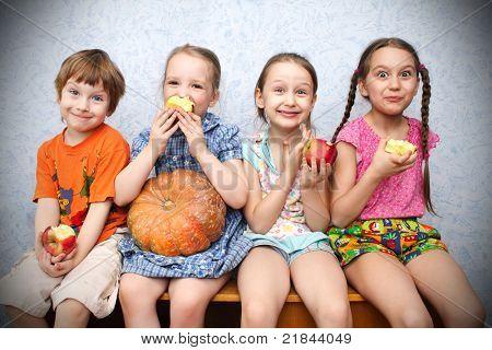 group of preschool children to eat apples