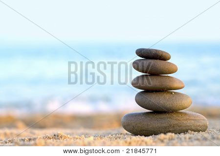 Rocks Stacked one on top of another on the background of the sea