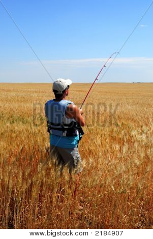 Farmer Fishing In Wheat Field