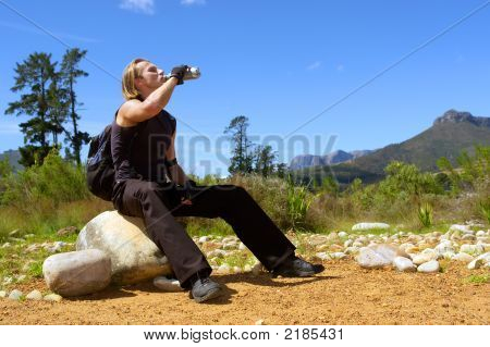 Young Attractive Man Drinks Water