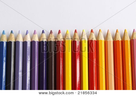 Colorful Pencil Crayons On A White Background, Education Background