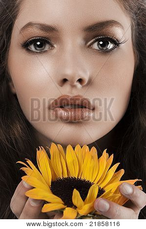 Summer Portrait Of A Young Girl With Sunflower
