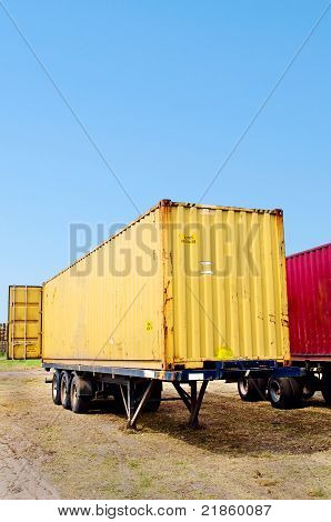 trailer with yellow container