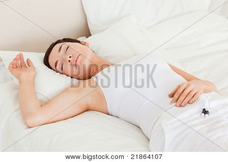 Calm woman having a nap in her bedroom