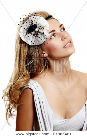 young woman portrait wearing beautiful vintage wedding headband on  long curly hair and smiling over her shoulder
