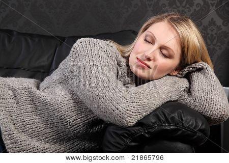 Beautiful Blond Woman Asleep In Grey Knit Sweater