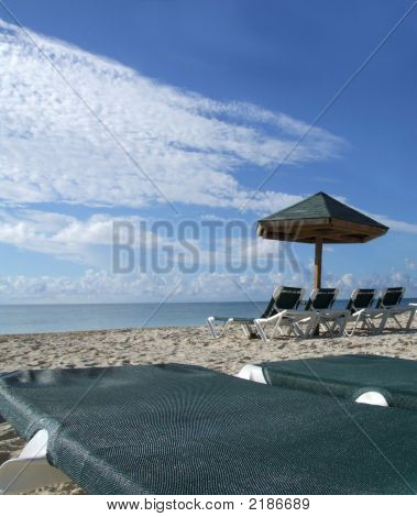 Lounge Beach Chairs With An Amazing Blue Sky