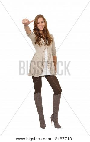 Young Woman With Boots Shows Thumbs