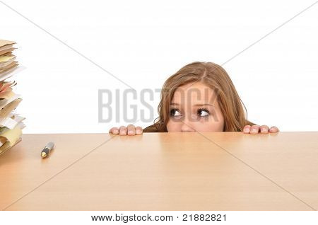 Young Woman Hiding Behind The Desk