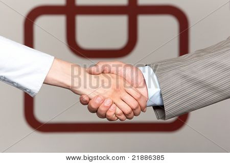 Photo of partners? hands making agreement by handshaking