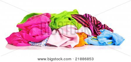 Big heap of colorful clothes   isolated on white background