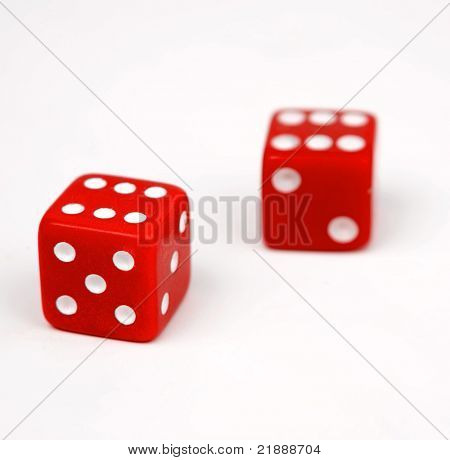 Two red dice isolated on white background